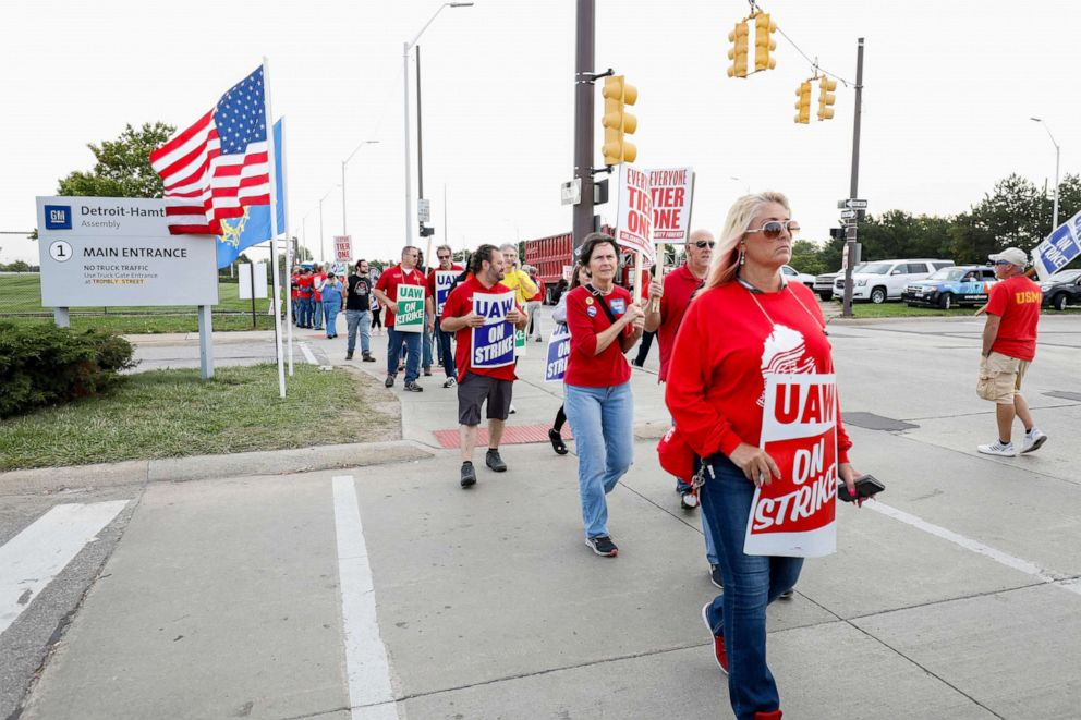 PHOTO: Striking United Auto Workers union members picket at the General Motors Detroit-Hamtramck Assembly Plant on September 25, 2019, in Detroit, Michigan.