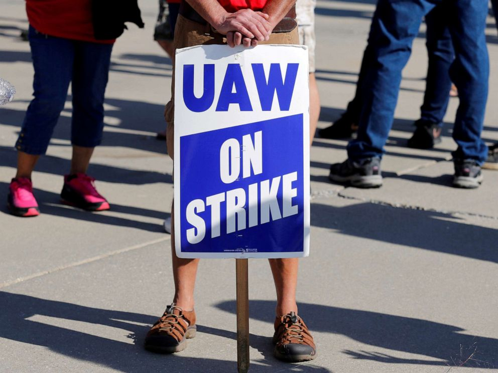 PHOTO: A striking worker holds a sign outside the shuttered General Motors Lordstown Assembly plant during the United Auto Workers national strike in Lordstown, Ohio, Sept. 20, 2019.