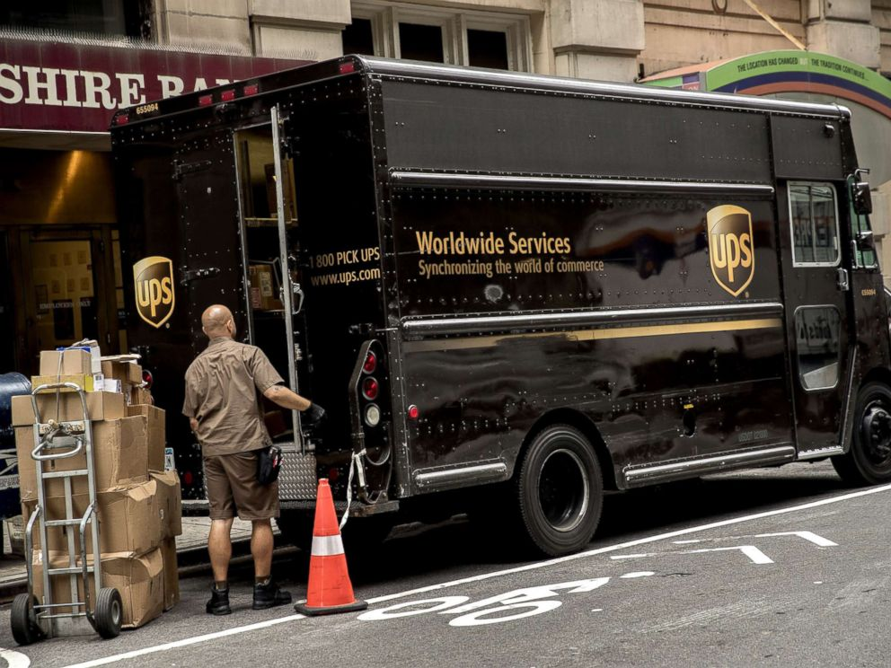 PHOTO: A driver for an independent contractor to United Parcel Service Inc. (UPS) prepares to load packages onto a delivery truck on a street in New York, July 24, 2017.