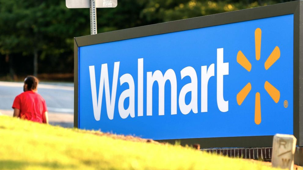 A man walks by the entrance to a Walmart store in Decatur, G.a., on Aug. 27, 2015.