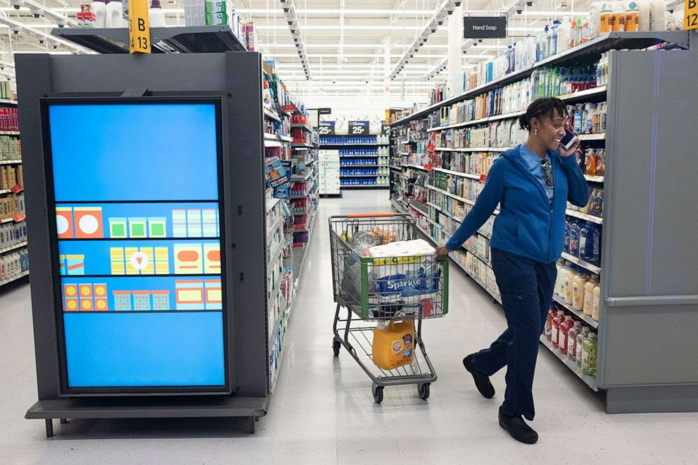 PHOTO: A customer pulls her shopping cart past an information kiosk at a Walmart Neighborhood Market, April 24, 2019, in Levittown, N.Y.