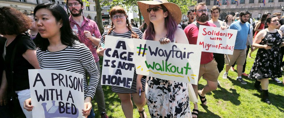 PHOTO: Employees of Wayfair march to Copley Square in protest prior to their rally in Boston, June 26, 2019, in response to the companys decision to sell furniture for a detention center holding migrant children in Texas.