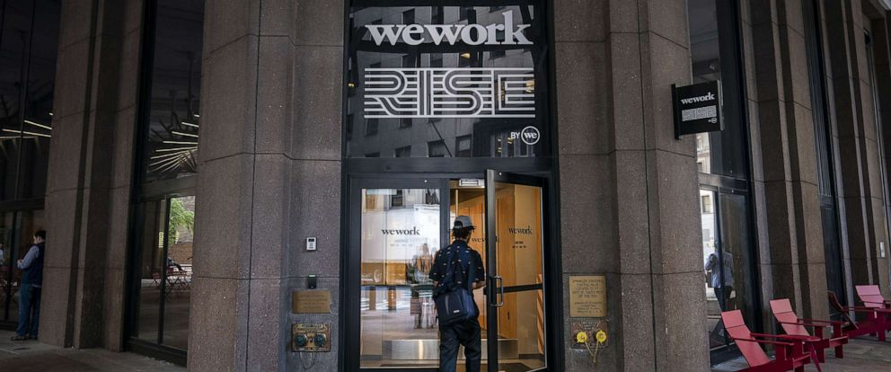 PHOTO: A man enters a WeWork office facility stands in the Financial District in New York City, Sept. 13, 2019.