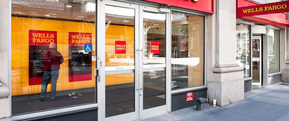 PHOTO: A customer uses the ATM at a Wells Fargo bank branch in New York, April 22, 2018.