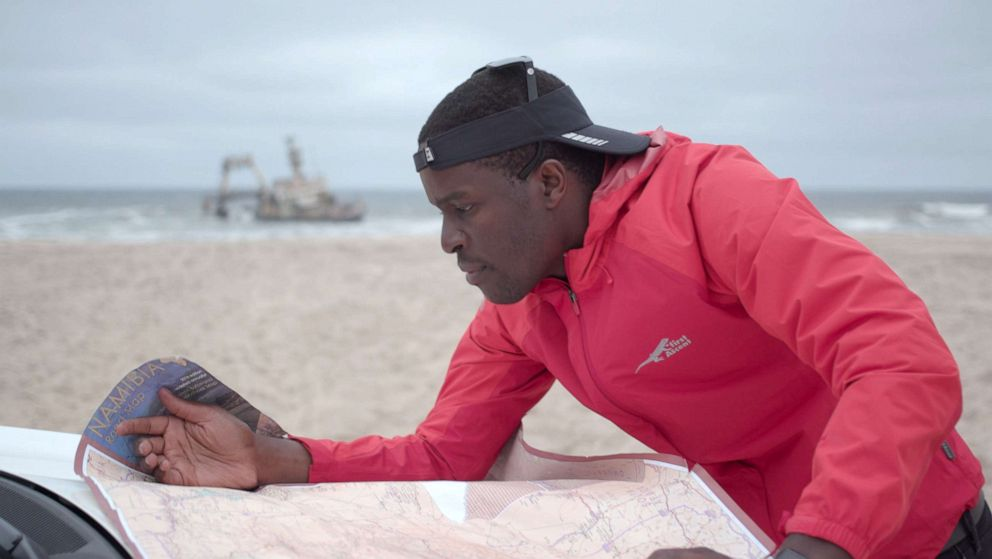 PHOTO: Tawanda Kanhema is pictured here planning a mapping route in Swakopmund, Namibia.