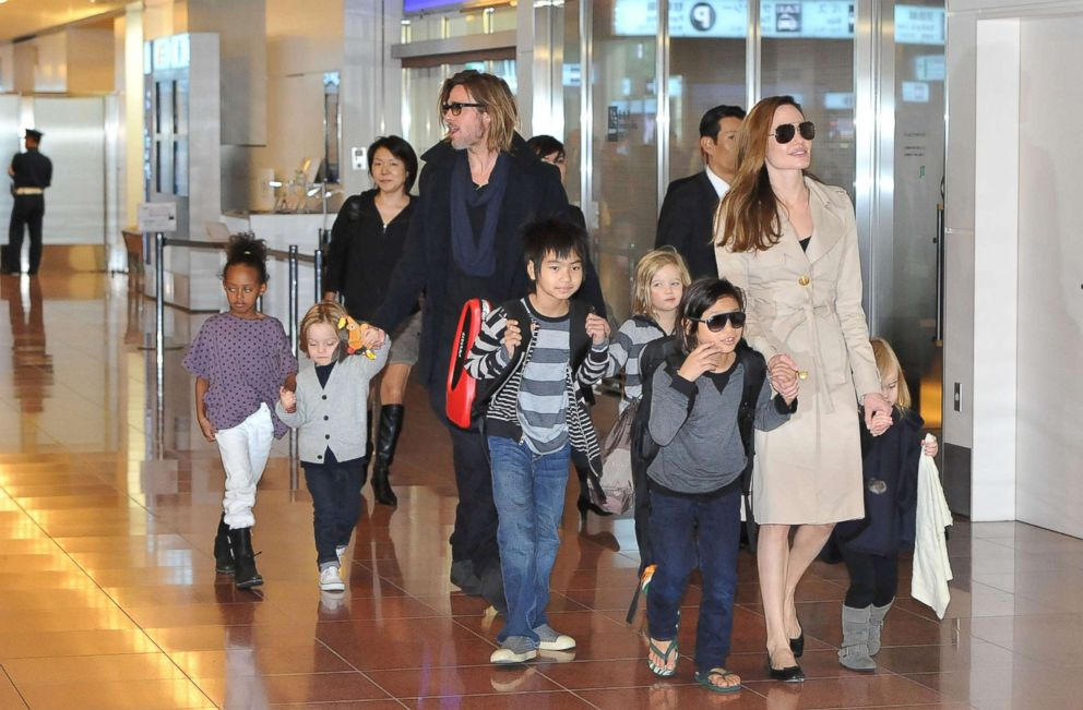 Brad Pitt Angelina Jolie and their six children Maddox Pax Zahara Shiloh Knox and Vivienne arrive at Haneda International Airport Nov. 8 2011 in Tokyo
