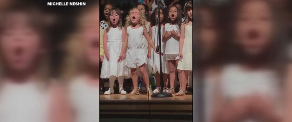 "Michelle Neshins video of her ""spunky"" daughter Sophia passionately singing at her graduation ceremony has gone viral."
