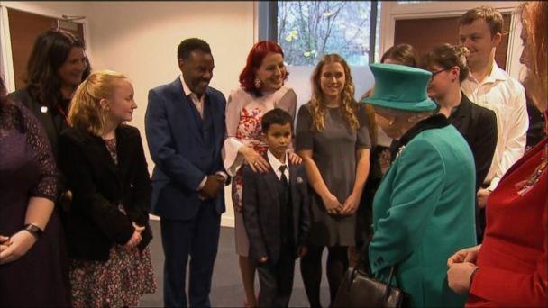 Boy crawls away from Queen Elizabeth II