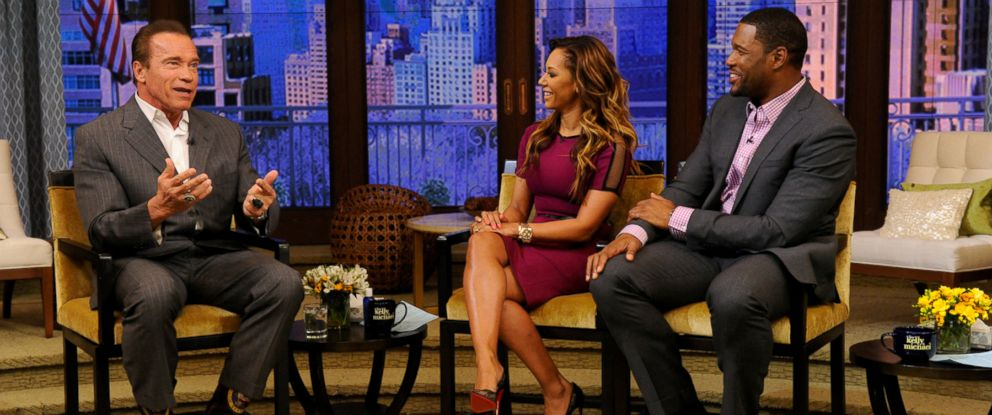 "PHOTO: Mel B. and Michael Strahan talk with Arnold Schwarzenegger during ""Live! with Kelly and Michael"" in New York, March 25, 2014."
