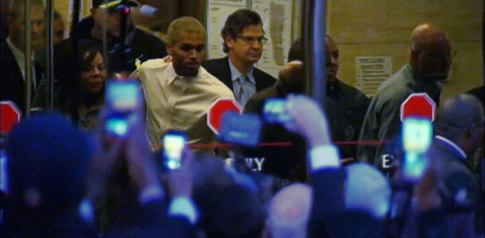 PHOTO: Chris Brown is seen leaving court, Oct. 28, 2013.