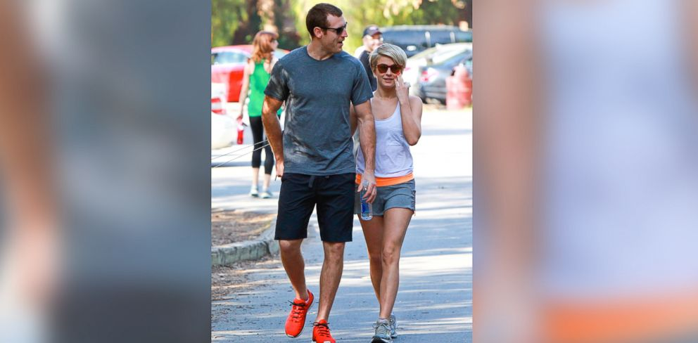 PHOTO: Julianne Hough holds hands with Canadian hockey player Brooks Laich while going out for a hike with her two dogs on Feb. 16, 2014.