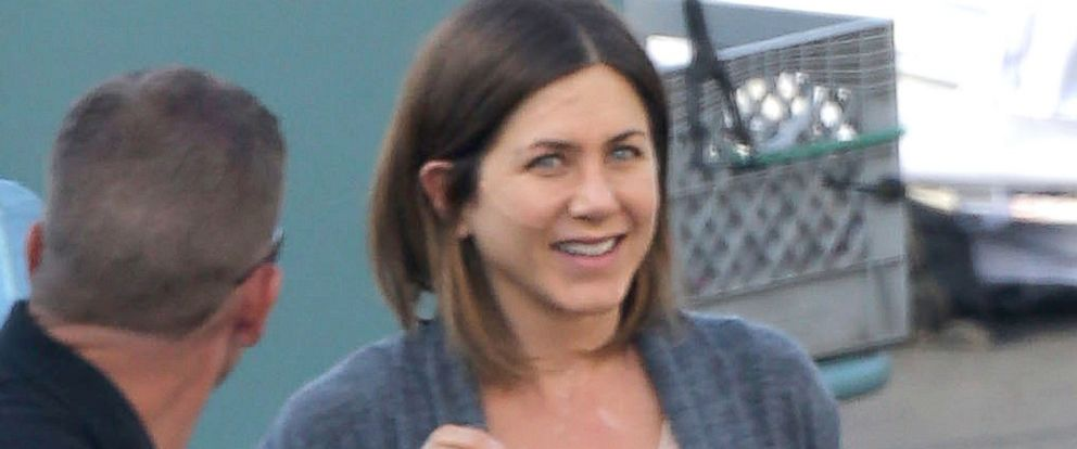 """PHOTO: Jennifer Aniston has a few laughs with one of the crew members on the set of her new movie """"Cake""""."""