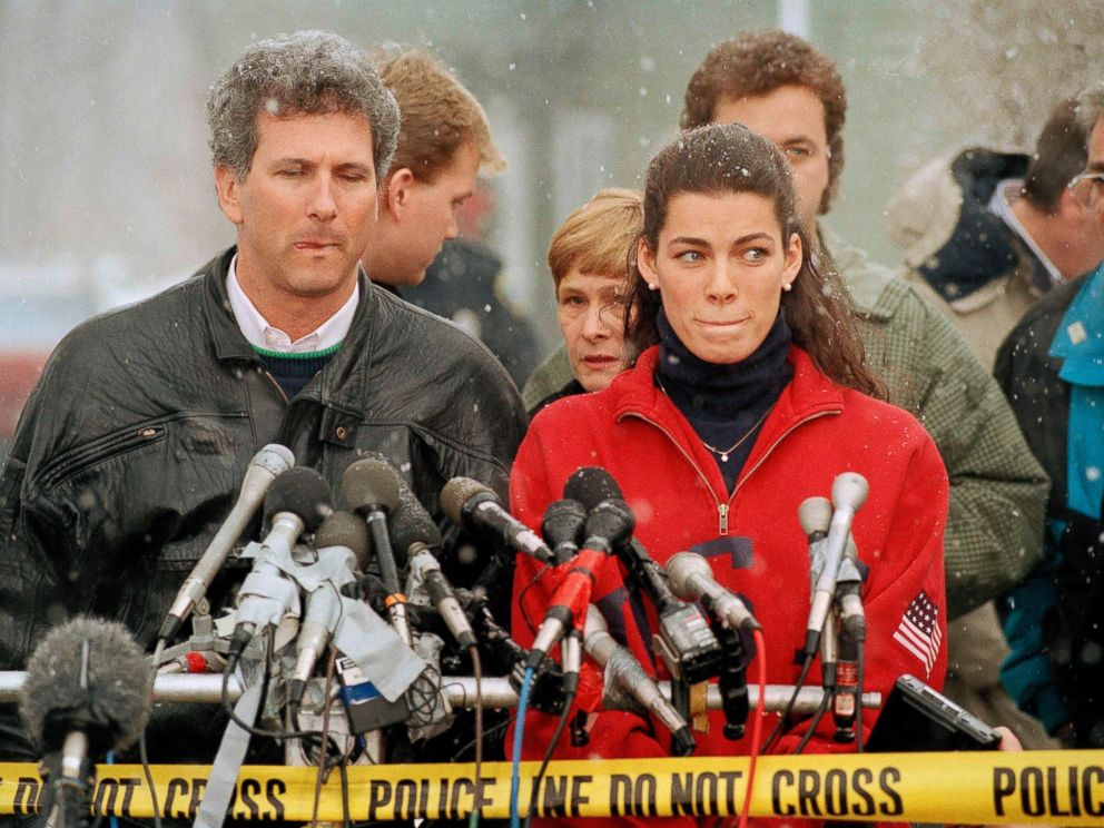 PHOTO: Olympic figure skater Nancy Kerrigan stands at a news conference in Boston, Jan. 14, 1994, as her agent Jerry Solomon, left, looks on.