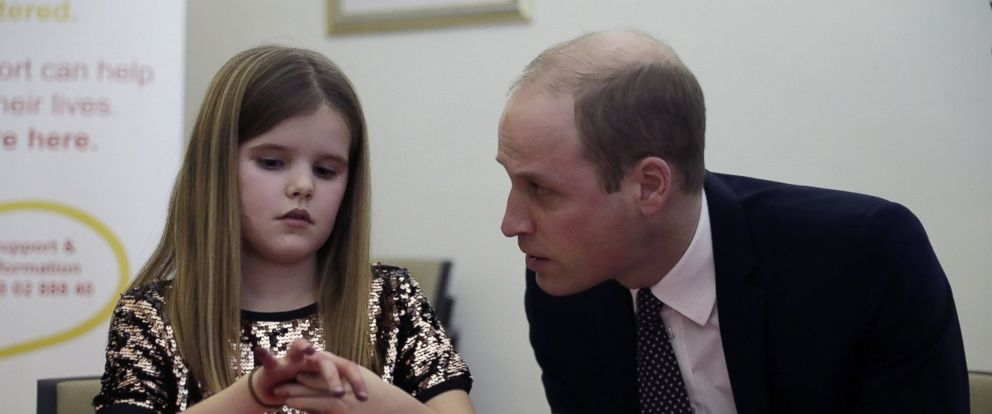 PHOTO: The Duke of Cambridge speaks with Aoife, 9, during a visit to Child Bereavement UKs center in Stratford, east London on Jan. 11, 2017.