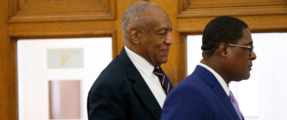 PHOTO: Andrew Wyatt, right, leads Bill Cosby, left, out of the courtroom during a lunch break in Cosbys sexual assault trial at the Montgomery County Courthouse in Norristown, Pa., June 12, 2017.