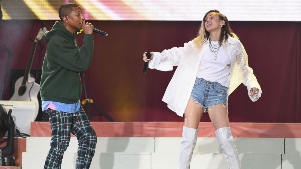 Singers Pharrell Williams, left, and Miley Cyrus perform at the One Love Manchester tribute concert in Manchester, north western England, June 4, 2017.