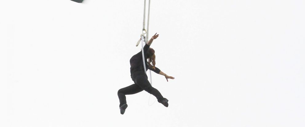 PHOTO: Erendira Wallenda, hangs by her teeth while suspended from a helicopter above Niagara Falls in Niagara Falls, N.Y., June 15, 2017.