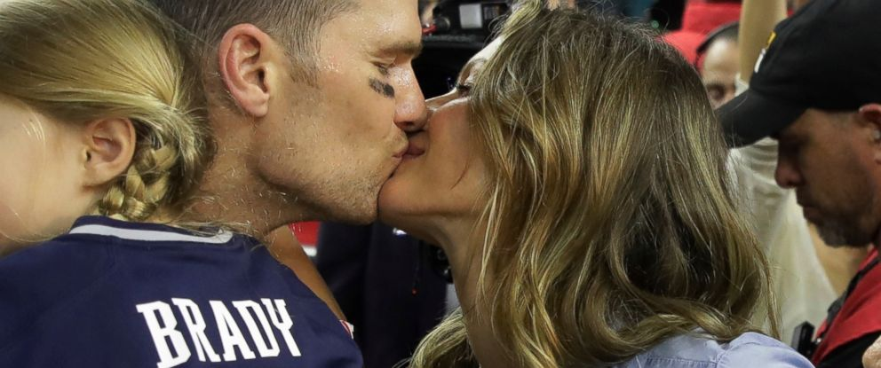 PHOTO: New England Patriots Tom Brady kisses his wife Gisele Bundchen after his team defeated the Atlanta Falcons in overtime at the NFL Super Bowl 51 football game, Feb. 5, 2017, in Houston.