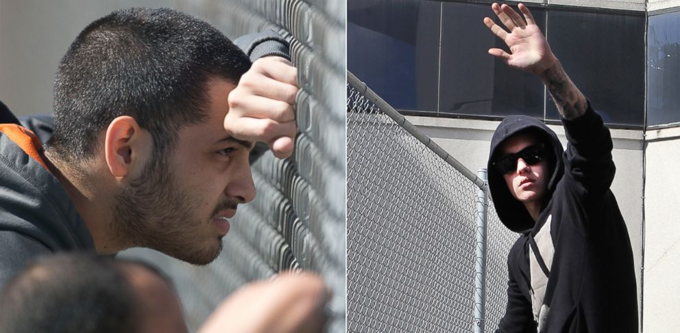 PHOTO: Fans and onlookers gathered outside the correctional facility where Justin Bieber was being held following his arrest in Miami Beach, Jan. 23, 2014. Bieber (right) later emerged and waved to the crowd.