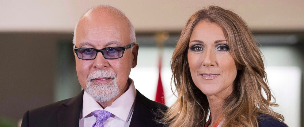 PHOTO: Canadian music star Celine Dion, right, and husband Rene Angelil posing for photos after being decorated with the Order of Canada on July 26, 2013 in Quebec City.
