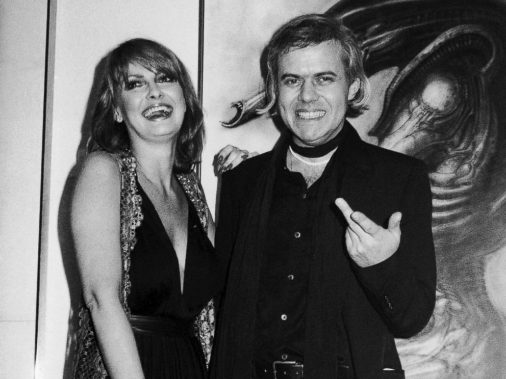 PHOTO: In this April 1980 file photo, Swiss artist H.R. Giger, right, poses with model Anneka Vasta at the opening of an exhibition in New York.