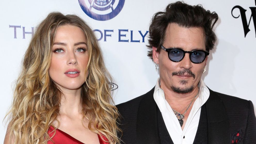 Amber Heard, left, and Johnny Depp arrive at The Art of Elysium's Ninth annual Heaven Gala at 3LABS, in Culver City, California, Jan. 9, 2016.