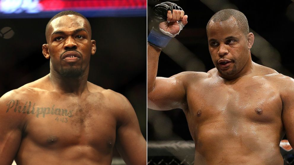 Jon Jones is seen in the ring before his UFC 159 Mixed Martial Arts light heavyweight title bout on April 27, 2013, in Newark, N.J. | Daniel Cormier is seen after fighting Frank Mir during a UFC heavyweight mixed martial arts fight on April 20, 2013, in San Jose, Calif.