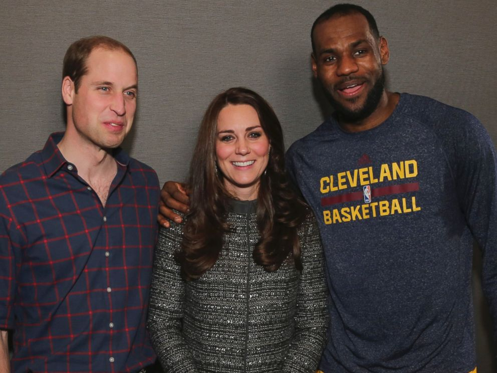Britains Prince William, left, and Kate, Duchess of Cambridge pose with Cleveland Cavaliers LeBron James, right, backstage of an NBA basketball game between the Cavaliers and the Brooklyn Nets on Monday, Dec. 8, 2014, in New York.