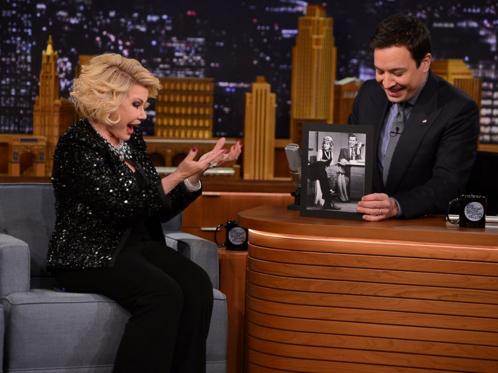 PHOTO: This March 27, 2014 photo released by NBC shows comedian Joan Rivers, left, with host Jimmy Fallon, during an appearance on The Tonight Show Starring Jimmy Fallon, in New York.