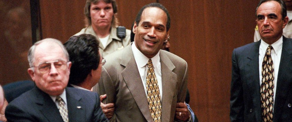 PHOTO: O.J. Simpson, center, reacts after the jury found him not guilty in the murders of his ex-wife Nicole Brown Simpson and Ronald Goldman in a Los Angeles courtroom October 3, 1995. Attorneys F. Lee Bailey, left, and Robert Shapiro, right, look on.