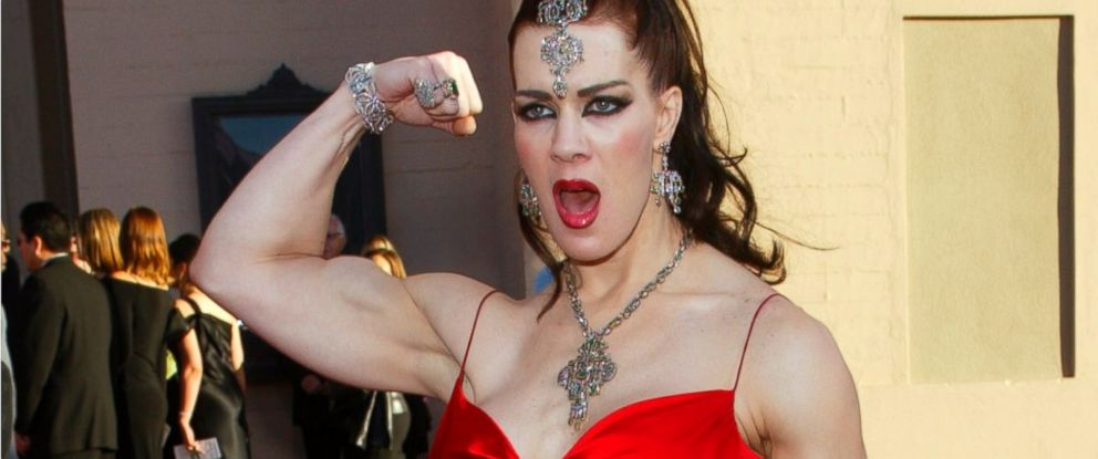PHOTO: Joanie Laurer, former pro wrestler known as Chyna, flexes her bicep as she arrives at the 31st annual American Music Awards, in Los Angeles, Nov. 16, 2003.