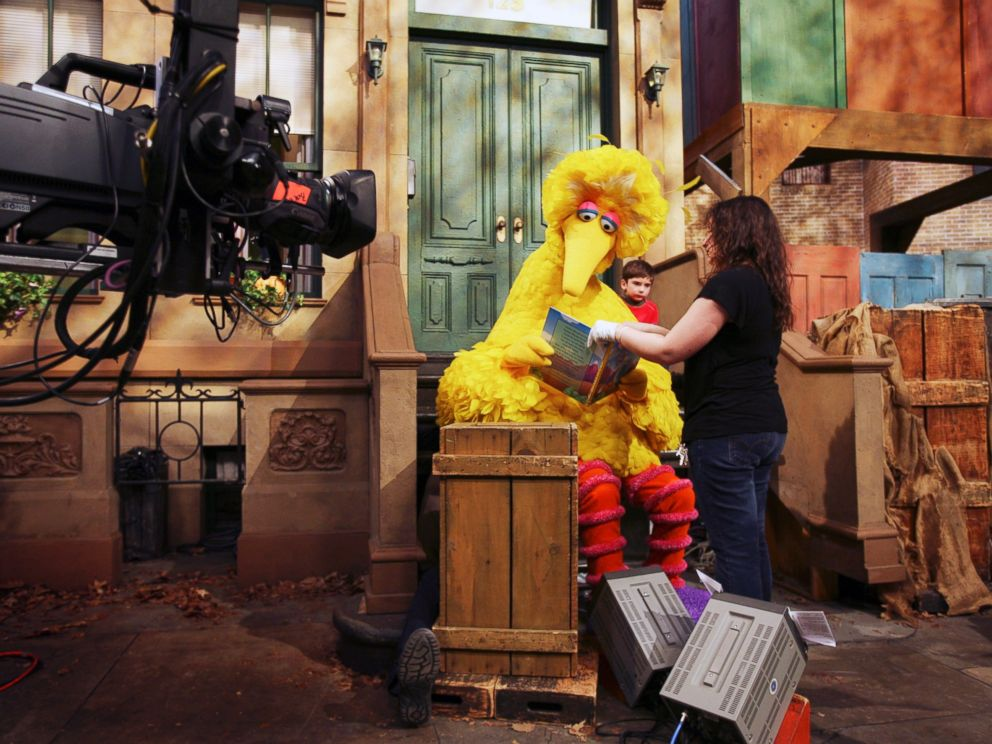 PHOTO: Michelle Hickey, a Muppet wrangler adjusts a book for Big Bird, voiced by Carroll Spinney, so he can read to Connor Scott during a taping of Sesame Street in New York, April 10, 2008.