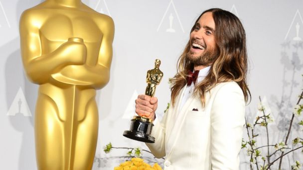 """PHOTO: Jared Leto poses in the press room with the award for best actor in a supporting role for """"Dallas Buyers Club"""" during the Oscars at the Dolby Theatre in Los Angeles, March 2, 2014."""