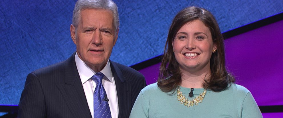 "PHOTO: Alex Trebek, host of the TV show ""Jeopardy!,"" poses with contestant Julia Collins, 31, of Kenilworth, Ill., during the taping of her shows on stage at JEOPARDY!, Sony Pictures Studios, Culver City, Calif., Jan. 2014."