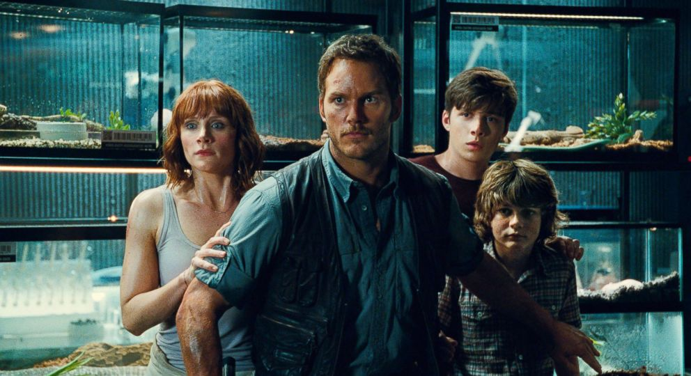 PHOTO: Bryce Dallas Howard, from left, as Claire, Chris Pratt as Owen, Nick Robinson as Zach, and Ty Simpkins as Gray, in a scene from the film, Jurassic World.