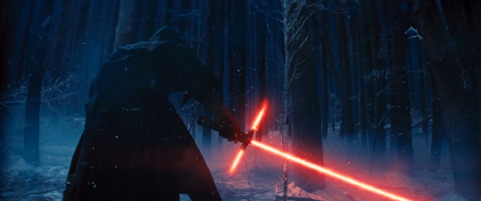 "PHOTO: Adam Driver as Kylo Ren with his Lightsaber in a scene from the new film, ""Star Wars: The Force Awakens."""