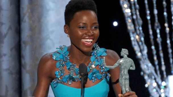 "PHOTO: Lupita Nyongo accepts an award for her role in ""12 Years a Slave"" at the 20th annual SAG Awards, Jan. 18, 2014, in Los Angeles"