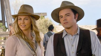 """PHOTO: Seth MacFarlane, right, and Charlize Theron in a scene from """"A Million Ways to Die in the West."""""""