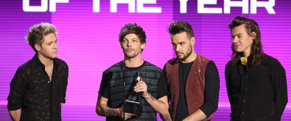 PHOTO: Niall Horan, Louis Tomlinson, Liam Payne, and Harry Styles of One Direction accept the award for artist of the year at the American Music Awards at the Microsoft Theater, Nov. 22, 2015, in Los Angeles.