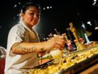 PHOTO: Pastry chef Jessica Contreras sprays gold dust on chocolate Oscar statues at the Governors Ball Press Preview for the 86th Oscars, on Thursday, Feb. 20, 2014, in Los Angeles.
