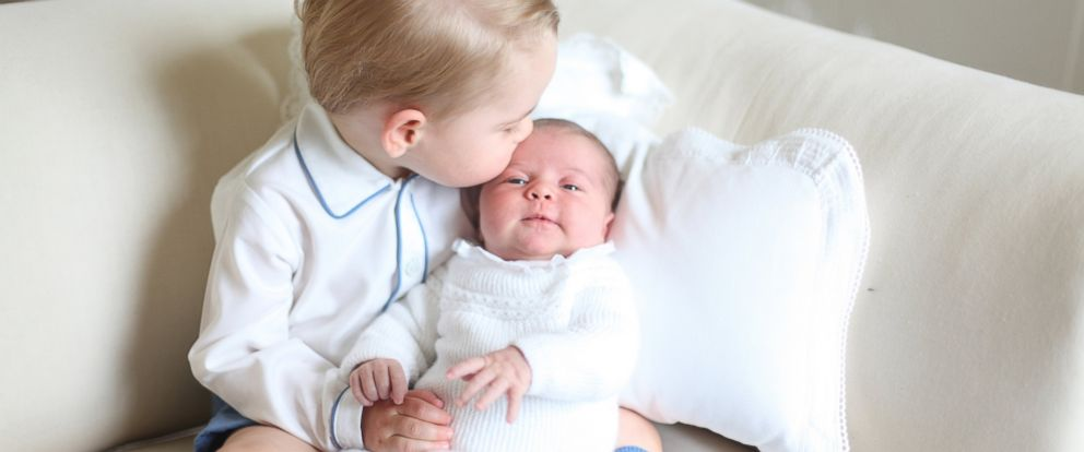 PHOTO: Britains Princess Charlotte, right, being held by her brother, 2-year-old, Prince George.