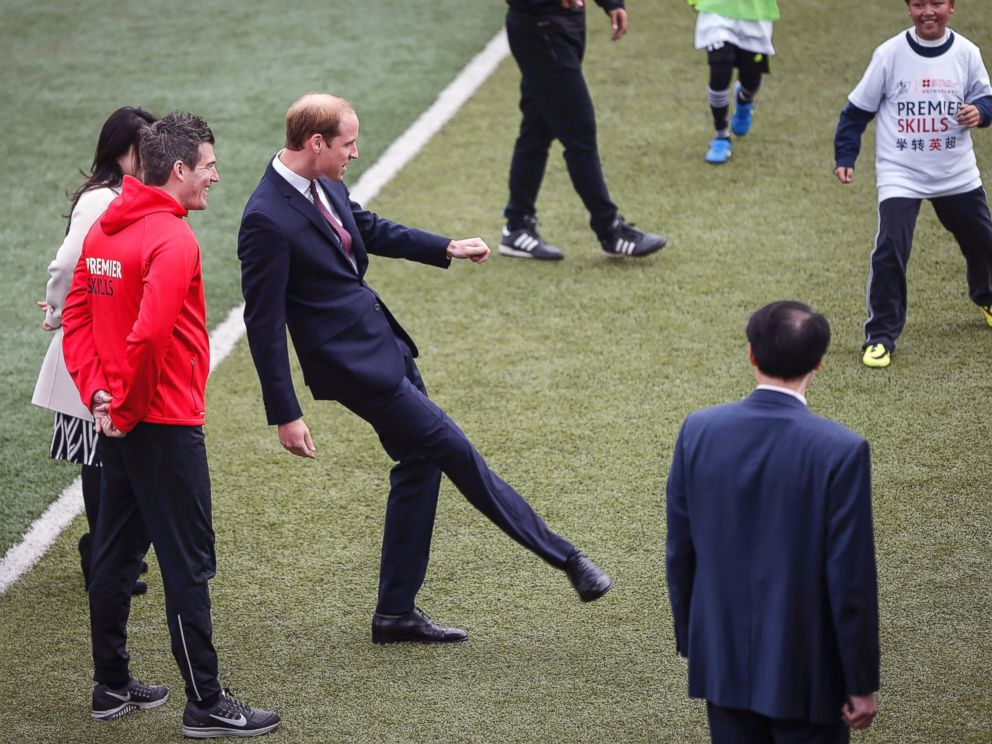 PHOTO: Britains Prince William, center, kicks a ball as he attends the Premier Skills football coaching event at Nanyang Secondary School in Shanghai, March 3, 2015.