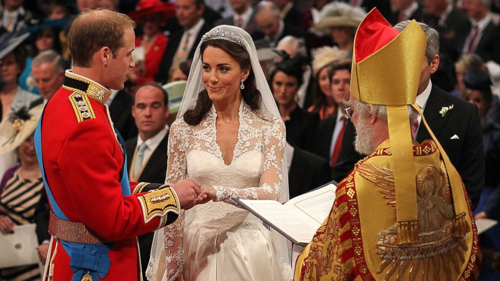 Britain's Prince William and Kate Middleton exchange rings in front of the Archbishop of Canterbury at Westminster Abbey, London, April 29, 2011.