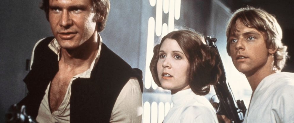 """PHOTO: From left, Harrison Ford, Carrie Fisher and Mark Hamill are pictured in a scene from """"Star Wars"""" in 1977."""