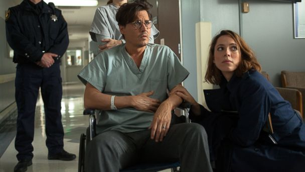 "PHOTO: Johnny Depp, left, as Will Caster and Rebecca Hall as Evelyn Caster in ""Transcendence."""