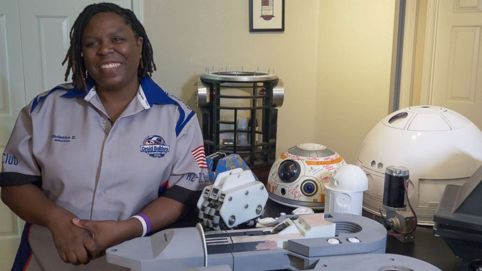 PHOTO: Christina Cato of the R2-D2 Builders Club with some of her droid works-in-progress.
