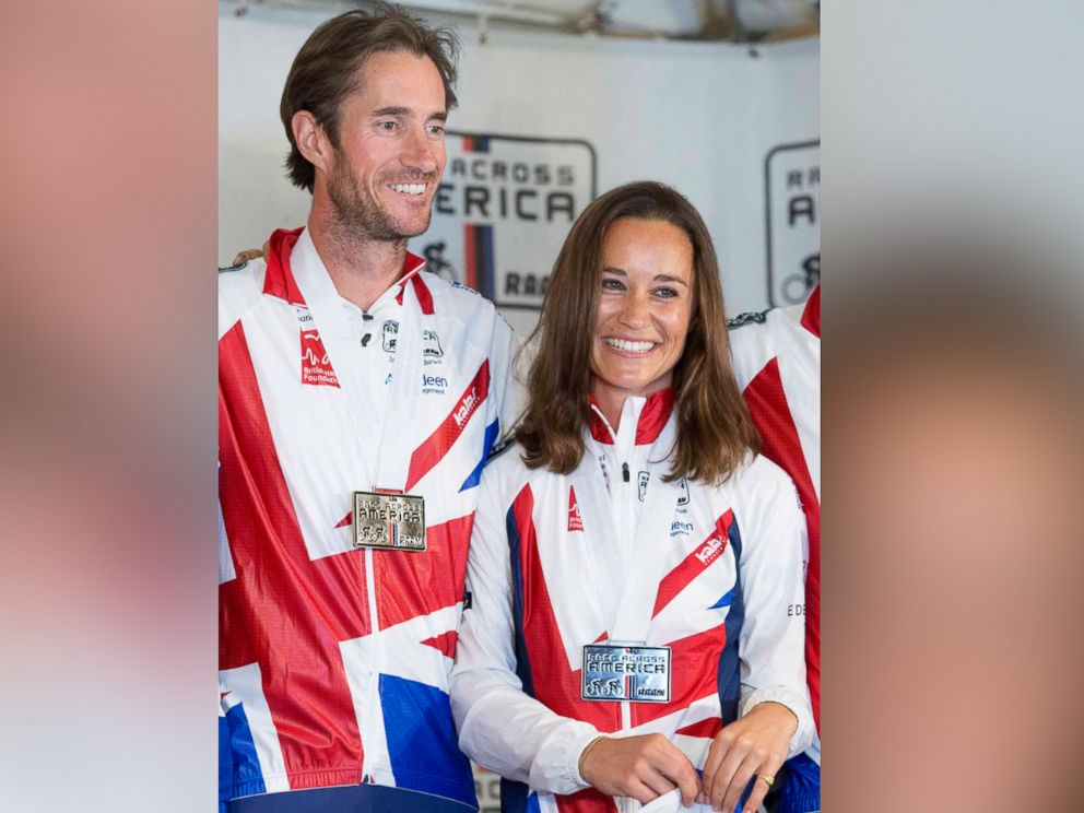 PHOTO: Pippa Middleton and James Matthews pose for photos after finishing their Race Across America bike race in Annapolis, Maryland, June, 21, 2014.
