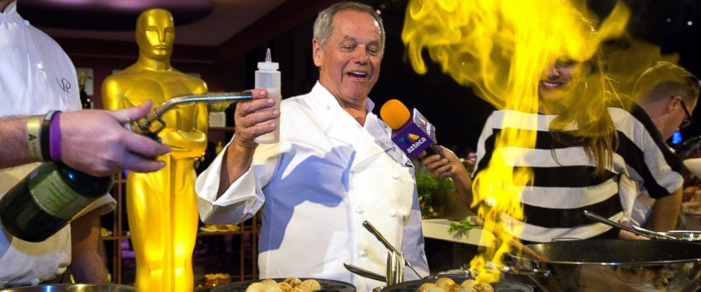 PHOTO: Wolfgang Puck, center, lights up a specialty donut during the press preview of the 88th Oscars Governors Ball in Hollywood, Calif., Feb. 18, 2016. The event is the official post-Oscars celebration that will take place on Feb. 28.