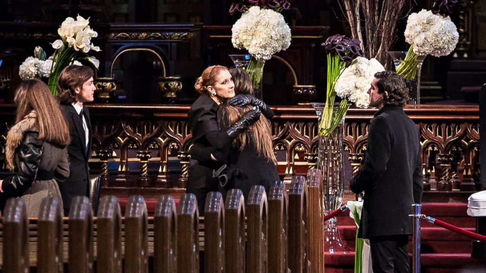 dc45ead4fa Celine Dion and family members observe as the priest conducts a memorial  service before the public