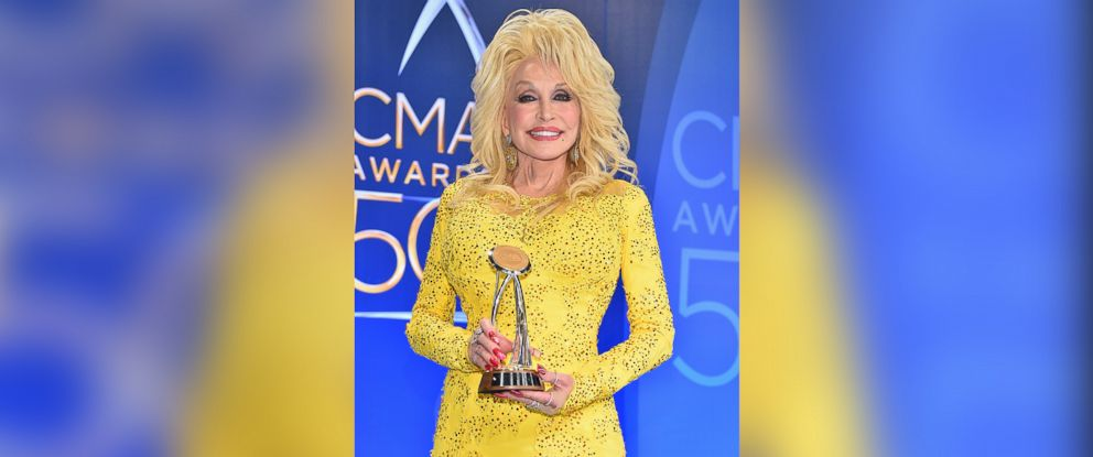 PHOTO: Recipient of the Willie Nelson Lifetime Achievement Award Dolly Parton poses backstage at the 50th annual CMA Awards at the Bridgestone Arena on November 2, 2016 in Nashville, Tennessee.